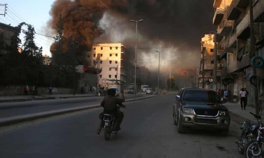 Smoke billows in a rebel-held part of the Syrian city of Aleppo following a reported air strike on 9 July, 2016, despite a supposed ceasefire.