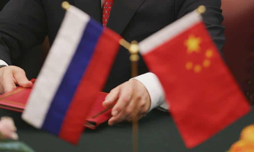Flags of Russia and China.