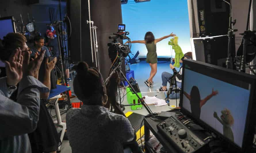 Production members clap for Salia Woodbury, left, on the set with Karli and the puppeteer Haley Jenkins.