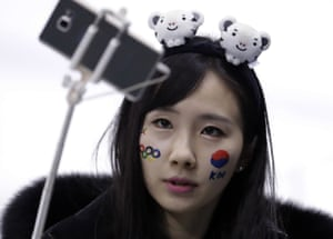 A face-painted South Korea fan takes a selfie