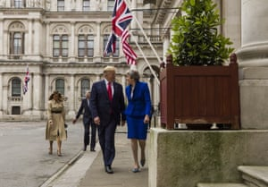 President Donald Trump walks with British Prime Minister Theresa May to a news conference at the Foreign Office