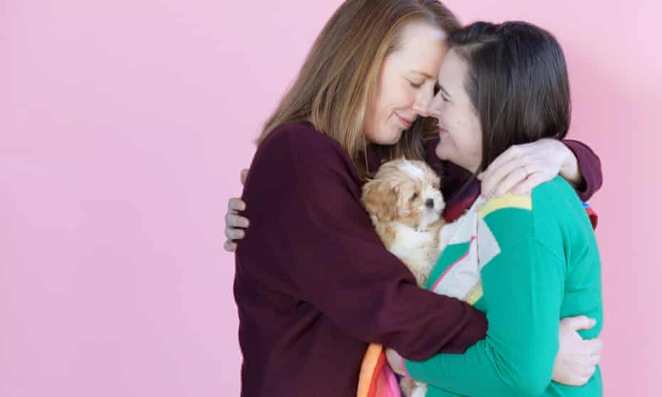 Rachel and Kerry Howells-Brewer and Rainbow the pup, London