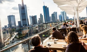 The skyline of Frankfurt's business district as seen from a rooftop bar.
