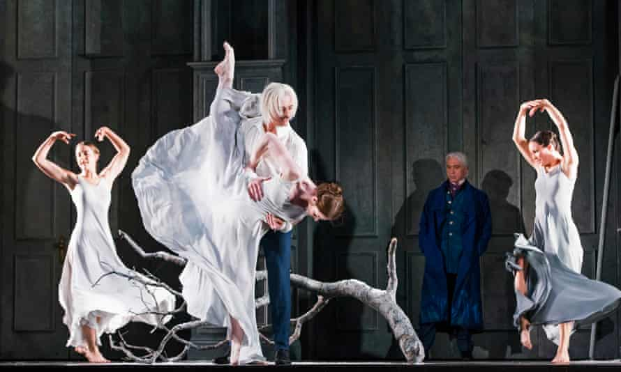 Emotional resonance … Tom Shale-Coates as Young Onegin, with Dmitri Hvorostovsky looking on in the title role of Eugene Onegin at the Royal Opera House, London.