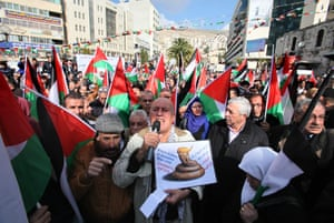 Nablus, West Bank Palestinians hold Palestine flags during a demonstration against proposed plans by Donald Trump to move the US embassy in Israel to Jerusalem