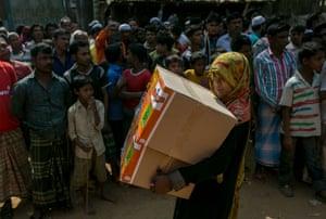 Rohingya refugees gather as the Nautical Aliya crew distributes food and hygiene supplies at Kutapalong refugee camp