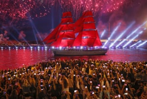 St Petersburg, Russia: People watch fireworks and a brig on the Neva River during the Scarlet Sails festivities marking nationwide graduation week for primary and secondary schools, and military academies
