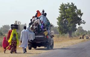 People flee from Boko Haram, in Mairi village on the outskirts of Maiduguri
