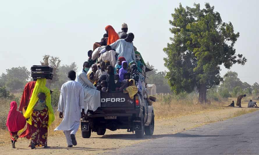 People flee after Boko Haram attacks on Mairi village, on the outskirts of Maiduguri in Borno