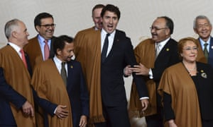 Justin Trudeau (centre) jokes around with fellow leaders, including PNG prime minister Peter O'Neill (right of Trudeau) during the taking of the group photo, an annual tradition at the Apec leaders summit.