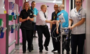 Boris Johnson meets staff at King's Mill NHS Hospital in Mansfield during the election campaign.
