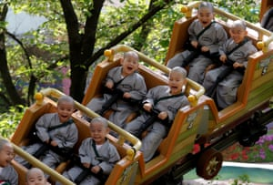 Yongin, South Korea: Boys who are staying in a temple for two weeks as novice monks enjoy a break at Everland amusement park