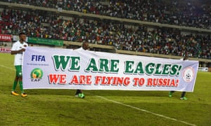 Nigeria players celebrate qualification after beating Zambia
