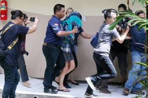 Australian Sara Connor (centre) is escorted by Indonesian police officers after being arrested over the alleged murder of a police officer in Bali.