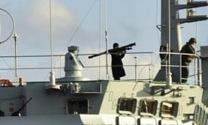 Turkey has accused Russia of provocation after a serviceman onboard a Russian ship crossing the Bosphorous strait was photographed holding a rocket launcher.