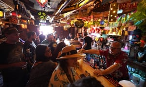 People enjoy tropical cocktails in the tiny interior of the Tiki-Ti bar on Sunset Boulevard in Los Angeles.