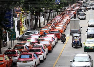 Bangkok, ThailandTaxis park around the finance ministry to protest and call on the government to offer assistance to drivers due to the impact of Covid-19