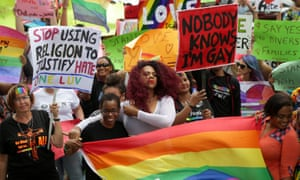 Members of the LGBT community demonstrate outside the hall of justice in Port of Spain, Trinidad and Tobago on 12 April.