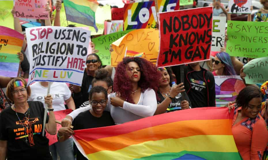 Members of the LGBT community await the court ruling outside the Hall of Justice in Port-of-Spain, Trinidad and Tobago.