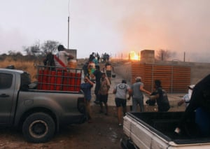 People attempt to control a fire at La Candelaria, in Cordoba province, Argentina