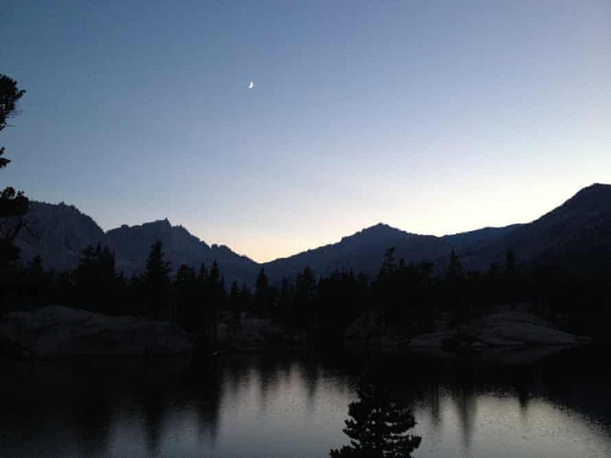 View of the Sierras from Sequoia national park with the moon high in the sky.