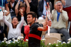 Djokovic reacts after winning a point in the fourth