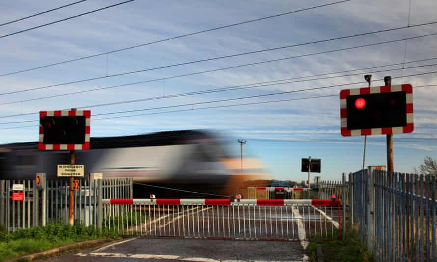A train passes through a level crossing