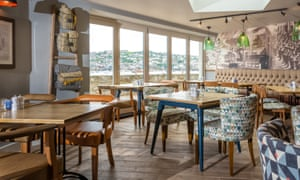 Interior shot of the restaurant area at Havener's Bar & Grill, Fowey, Cornwall, UK. There is a view out to Fowey harbour from one of the windows.