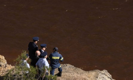 Police officials search for the bodies of Nicos Metaxas's victims.
