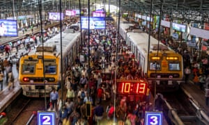 Workers get off a train at Churchgate station in Mumbai, India.