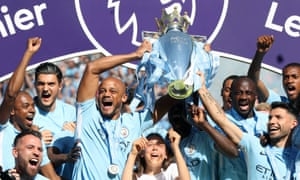 Yaya Touré and his Manchester City team-mates celebrate with the Premier League trophy, the Ivorian's third - and final - league title with the club.