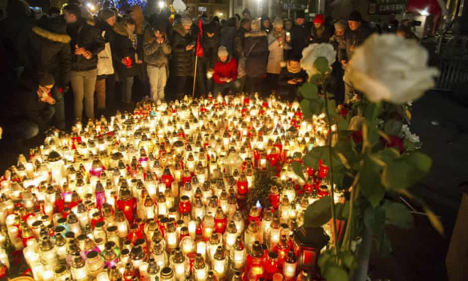 People place candles as they mourn the mayor of Gdansk, Pawel Adamowicz in Gdansk.