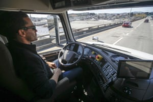 Matt Grigsby, senior program engineer at Otto, takes his hands off the steering wheel of a self-driving, big-rig truck during a demonstration on the highway, in San Francisco in 2016.