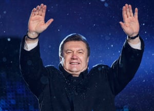 Viktor Yanukovych greets supporters during a campaign rally in Kiev in 2010.