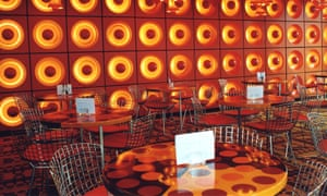 Bright orange and yellow tiling and tables in the Verner Panton's Spiegel Canteen