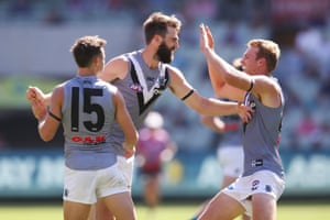 Port Adelaide celebrate an upset victory in round one over Melbourne at the MCG.