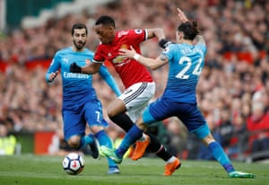 Martial goes past Bellerin and Mkhitaryan.