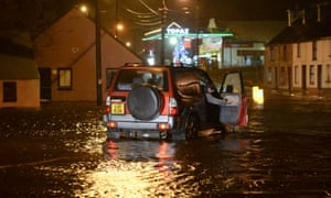 A car drives on a flooded road in Castlefynn in County Donegal, Ireland.