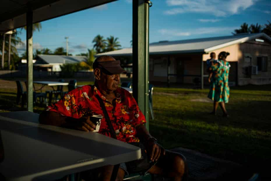 Voictor Nona, 80, a Badu Island elder, has a cup of coffee before a feast celebrating the tombstone revealing ceremony for his wife's grave.