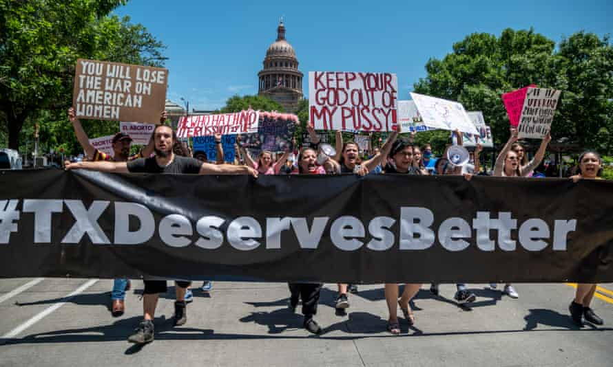 Protesters march outside the Texas state capitol in Austin.