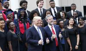 Donald Trump with Liberty University graduates and school president Jerry Falwell on Saturday.