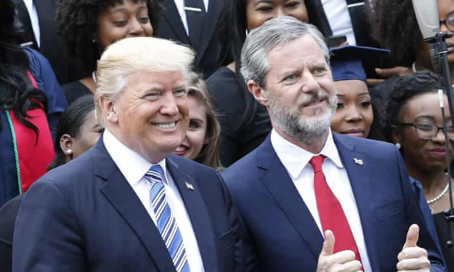 Donald Trump poses with Jerry Falwell Jr in May. Falwell said Trump's response to Charlottesville was 'bold' and 'truthful'.