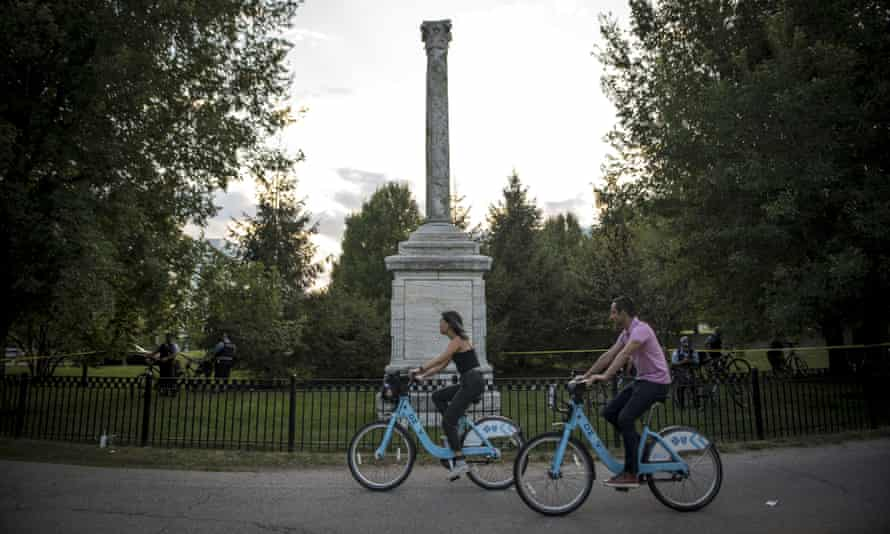 Cyclists using the bike-sharing program pass the Balbo Monument, a gift from Italian dictator Benito Mussolini to the city of Chicago in 1933.