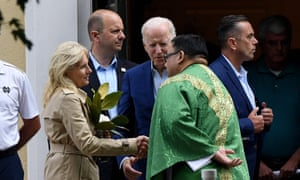 Photo by OLIVIER DOULIERY/AFP via Getty Images. US President Joe Biden (C) and First Lady Jill Biden (L) speak with a priest as they leave St. Joseph on the Brandywine Catholic Church in Wilmington, Delaware, June 19, 2021.