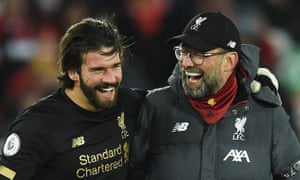Jürgen Klopp celebrates the 3-2 comeback win against West Ham with the Liverpool goalkeeper, Alisson, at Anfield.