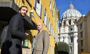 Italian journalists Emiliano Fittipaldi, left, and Gianluigi Nuzzi arrive for the first day of the so-called 'Vatileaks II' trial on Tuesday.