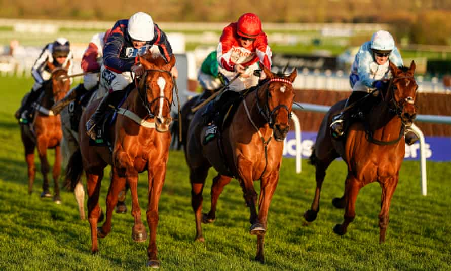 Song For Someone, left, with Aidan Coleman on board, begins to stretch out into a lead in the Unibet International Hurdle at Cheltenham.