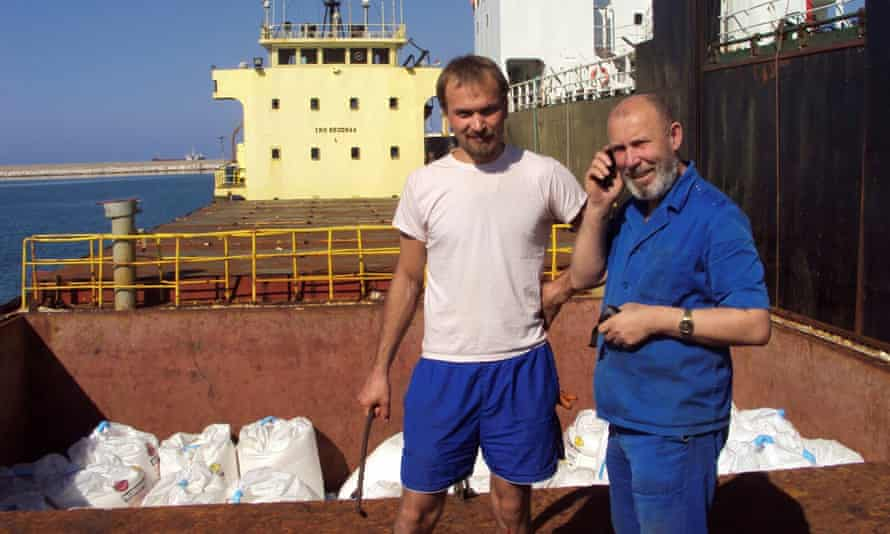 Boris Prokoshev, captain of cargo vessel Rhosus, and boatswain Boris Musinchak next to a freight hold in Beirut.