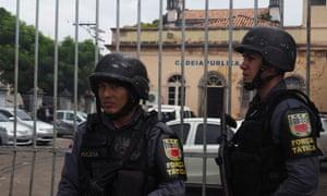 Police stand guard in front of Desembargador Raimundo Vidal Pessoa jail