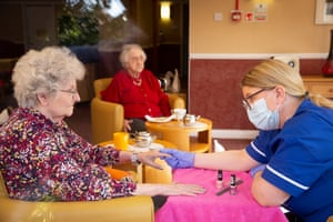 Social care assistant Audrey Halley runs a nail bar and manicure with resident Helen Ford at McClymont House